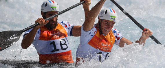 France's Gauthier Klauss (R) and Matthieu Peche compete in the Men's C2 semifinal canoe slalom competition at the Whitewater stadium during the Rio 2016 Olympic Games in Rio de Janeiro on August 11, 2016. / AFP PHOTO / Carl DE SOUZA